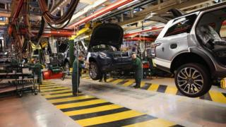 Range Rovers and Land Rovers on the production line