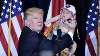 Donald Trump during the campaign, with baby