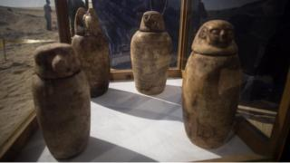 Four canopic jars, made of alabaster with lids bearing the faces of the four sons of god Horus, that were unearthed are displayed at the site of an ancient Egyptian cemetery, in Minya province, 245 km south of Cairo, Egypt.