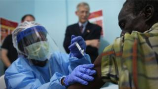 A nurse administers an injection on the first day of the Ebola vaccine study in Monrovia, Liberia, on February 2, 2015 .