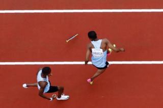 "World Athletics Championships - Men""s 4x400 Metres Relay - London Stadium, London, Britain – August 12, 2017. Karabo Sibanda and Nijel Amos of Botswana drop the baton."