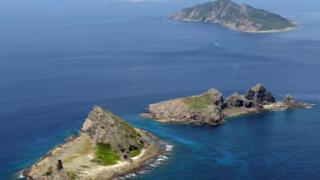 A group of disputed islands, Uotsuri island (top), Minamikojima (bottom) and Kitakojima, known as Senkaku in Japan and Diaoyu in China is seen in the East China Sea, in this photo taken by Kyodo September 2012.