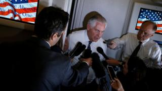 U.S. Secretary of State Rex Tillerson speaks to reporters en route with President Donald Trump to a NATO summit in Brussels aboard Air Force One May 24, 2017