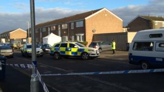 Tent and cordon outside a property in Duck Lane, St Neots