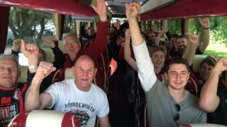 Fans on one of the coaches to Manchester