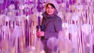 A woman walks through 'Entre Les Rangs', by Rami Bebawi and KANVA at Lewis Cubitt Park, King's Cross