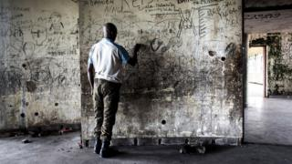 A member of the Republican Guard is seen inside the derelict palace complex of the former president of the Democratic Republic of the Congo (former Zaire), Mobutu Sese Seko on May 15, 2017 in Nsele, some 40kms outside Kinshasa. Sese Seko was expelled by rebel forces led by Laurent-Desire Kabila in 1997 after 32 years of absolute rule. He died in Morocco three months later in May 1997. / AFP