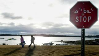 A stop sign in Iqaluit, the capital of the Canadian territory of Nunavut, is written in English and the syllabary form of the Inuktitut language.