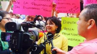 A file picture provided on 02 January 2016 shows Mayor of municipality of Temixco Gisela Mota (C) of the left wing party Partido de la Revolucion Democratica (PRD), speaking with journalists in Temixco, Mexico