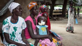 Families with malnourished children wait to receive treatment at the Leer Hospital, South Sudan, 7 July 2014