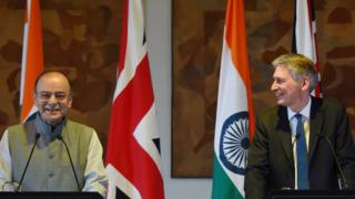 British chancellor Philip Hammond (R) and Indian Finance Minister Arun Jaitley take part in a joint press conference in New Delhi on April 4, 2017.