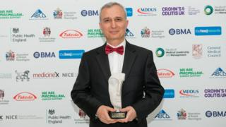 Dr Orhan Uzun with the BMJ award at the Westminster Park Plaza Hotel in London
