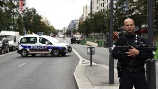 A police officer stands guard in a secured street in Villejuif, a suburb of Paris, on September 6, 2017