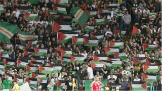 Fans display Palestine flags at Celtic's Champions League play-off first leg against Hapoel Beer Sheva