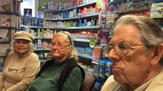 Worried elderly patients at a pharmacy