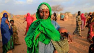 An internally displaced woman from drought hit area reacts after she complains about the lack of food at makeshift settlement area in Dollow, Somalia April 4, 2017
