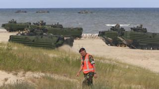 A Nato military exercise on a beach in Poland