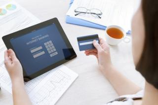 woman banking on tablet