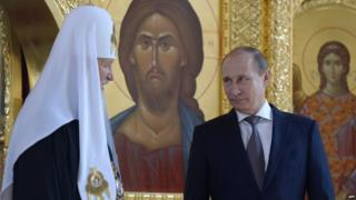 Patriarch Kirill of Moscow and All Russia (L) and Russian President Vladimir Putin (R)