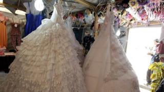 Wedding gowns in a stall in the northern Jordanian Zaatari refugee camp