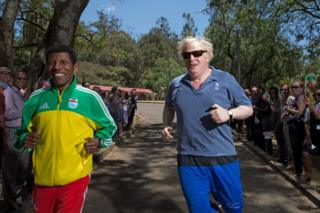 British Foreign Secretary Boris Johnson running along with retired Haile Gebrselassie, Ethiopia's legend of field and track