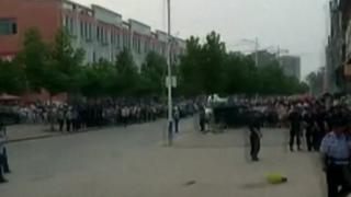 Crowd outside nursery in eastern China