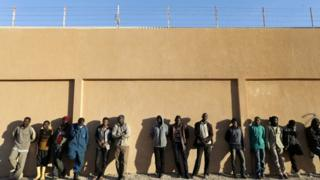 "Migrants stand in a detention centre run by the Inside ministry of Libya""s eastern-based government, in Benghazi, Libya, December 13, 2017."