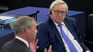 Jean-Claude Juncker listens to Nigel Farage