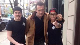 Liam Neeson with staff of the Big Star Sandwich Company in Vancouver