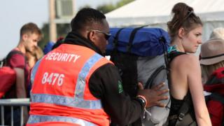 Woman being searched