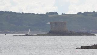 Yacht stranded on rocks off the Brehon Tower