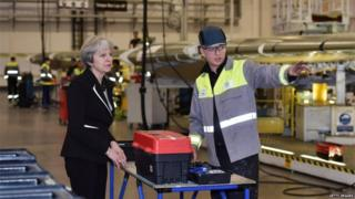 Prime Minister Theresa May speaks to a worker during a visit to the Belfast Bombardier factory in February 2018