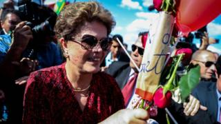Dilma Rousseff receives flowers as she leaves Alvorada Palace in Brasilia. 6 Sept 2016