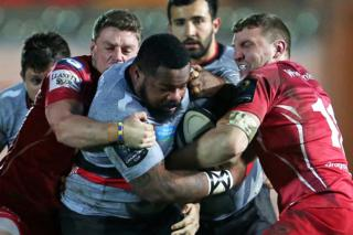 Toulon's French centre Mathieu Bastareaud is tackled during the European Rugby Champions Cup rugby union match between Llanelli Scarlets and Toulon