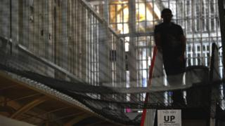 Prisoner standing at the top of a set of stairs