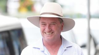 """Australian former Deputy Prime Minister Barnaby Joyce hands out """"how-to-vote"""" cards at a pre-poll in Glen Innes in the New England electorate, New South Wales, Australia, 29 November 2017"""