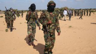 Somali Al-Shebab fighters gather on February 13, 2012 in Elasha Biyaha, in the Afgoei Corridor, after a demonstration to support the merger of Al-shebab and the Al-Qaeda network