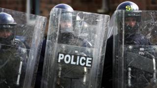 UK police with shields