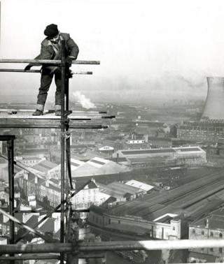 Scaffolder Douglas Tennant, from Barrowfield, photographed on scaffolding above Sauchiehall Street in 1964.
