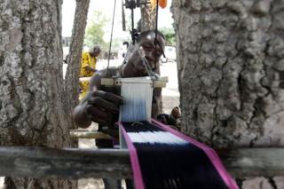 "A man weaves a ""baoule"" loincloth in N'gbekro, Ivory Coast, 12 April 2017."
