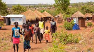 Refugee children from South Sudan walk in Bidibidi resettlement camp in the Northern District of Yumbe on April 14, 2017.