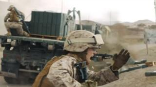 A screegrab from the Marine Corps recruiting advert showing a female Marine under fire