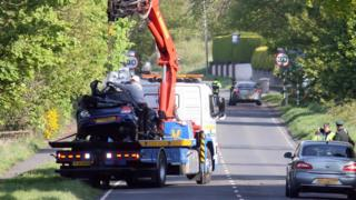The car in which Daryl Shaw was travelling being lifted on to a removal lorry