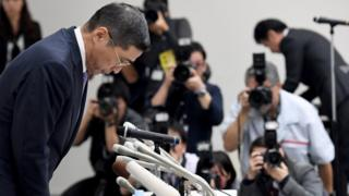 Nissan's Chief Executive Hiroto Saikawa bows in apology