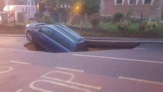 Car in hole