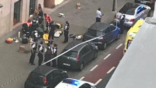 The scene in Brussels of the shooting by police of a man who reportedly attacked officers machete, 25 August 2017 