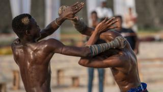 "Two young Dambe boxers fight during the Dambe Warriors Tournament held in Lagos on March 2, 2018. Dambe, a brutal style of fighting where one wrapped fist is a designated spear and the other a shield, is traditionally practised by Hausas in Nigeria""s north"
