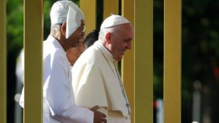 Pope Francis was welcomed to the capital by President Htin Kyaw (L)