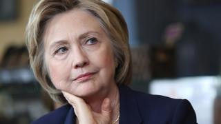 Hillary Clinton listens during a campaign stop in Virginia.