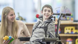 Disabled boy in wheelchair